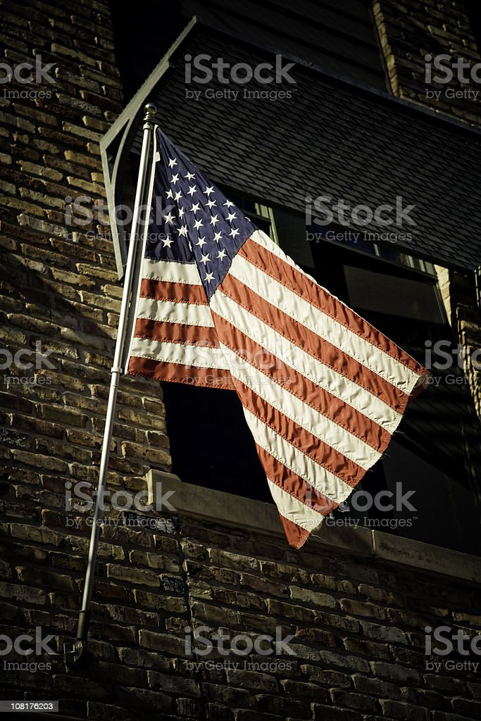 American Flag on Brick Wall royalty-free stock photo