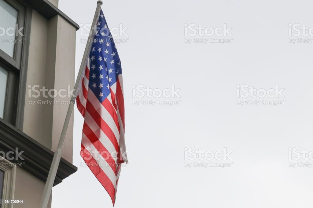 American flag on building, the  proudly displaying their stock photo