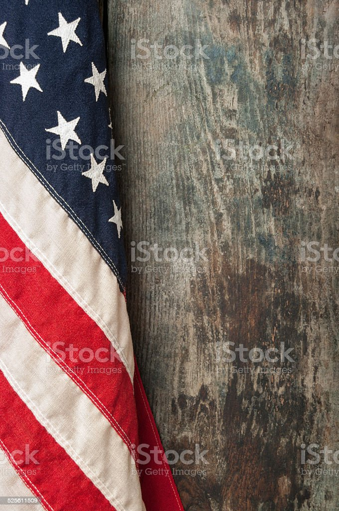 American flag on old barn board background stock photo