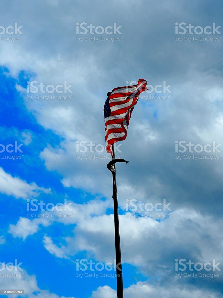American flag on the blue clouded sky stock photo