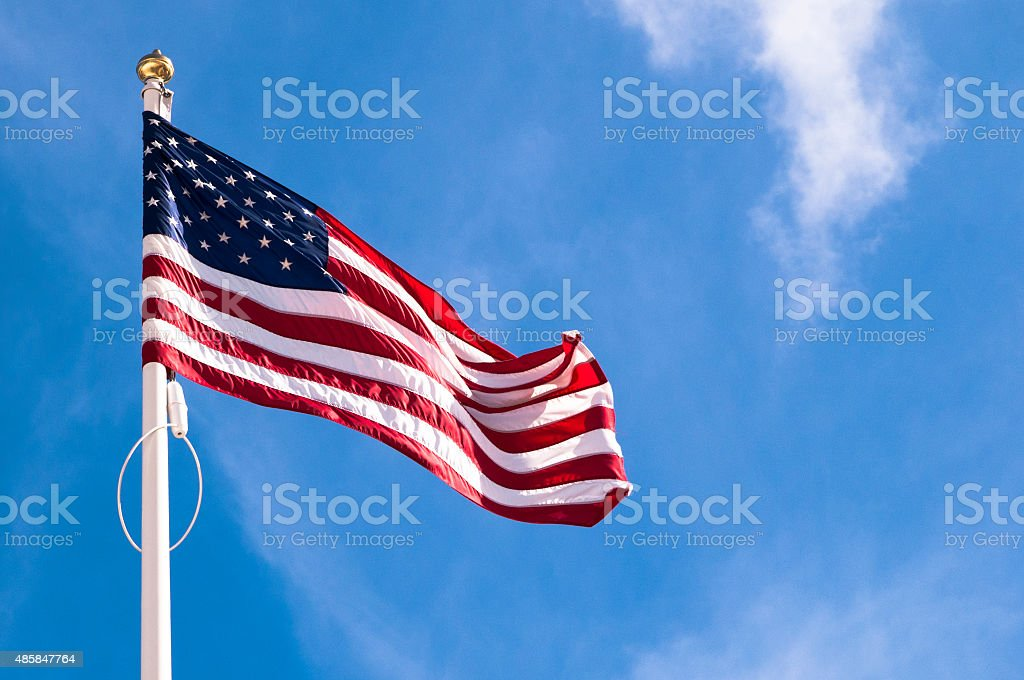 American flag on the blue sky, USA flag stock photo