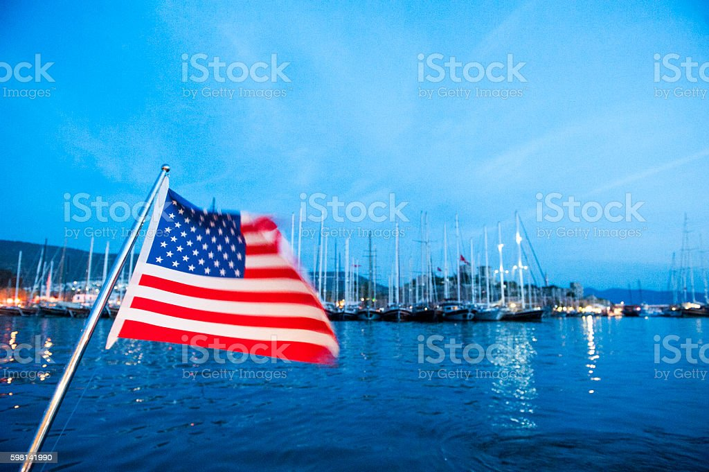 American flag on the deck of yacht in Bodrum harbor stock photo
