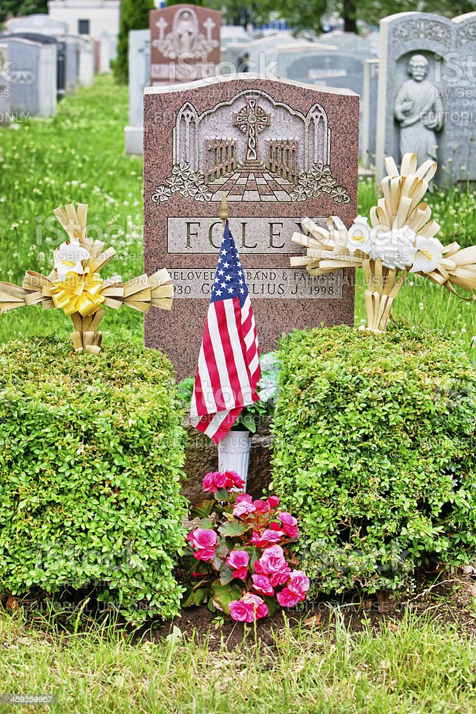 American Flag on tomb at Cemetery stock photo
