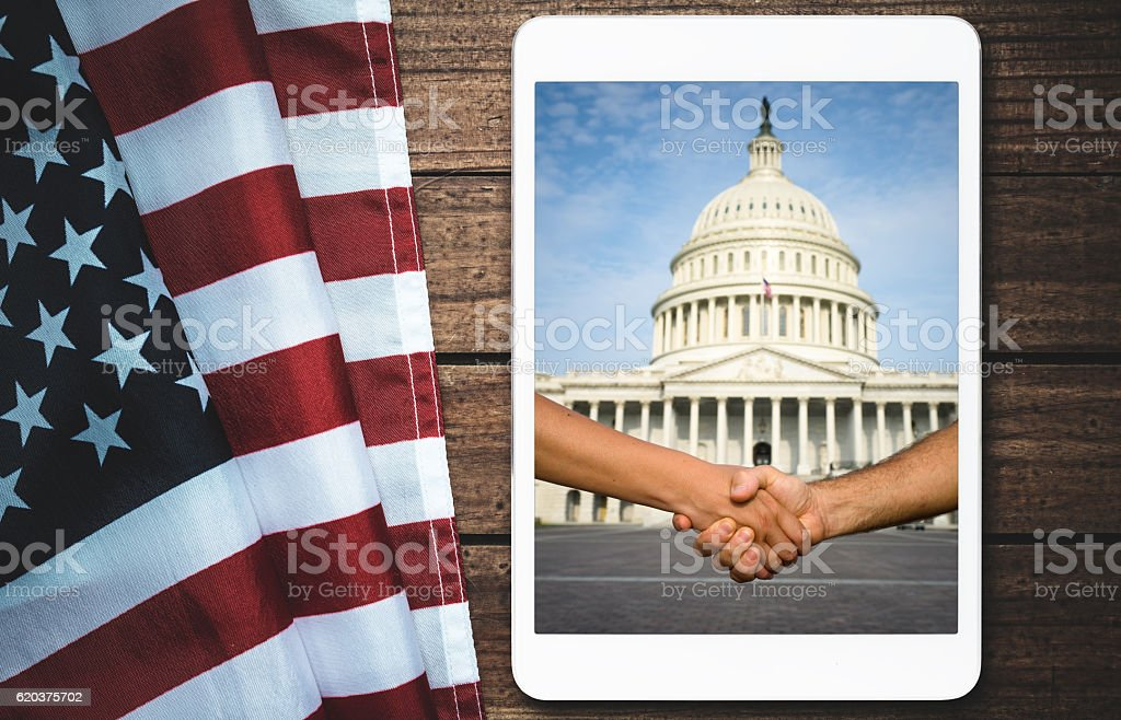 american flag on wood with tablet stock photo