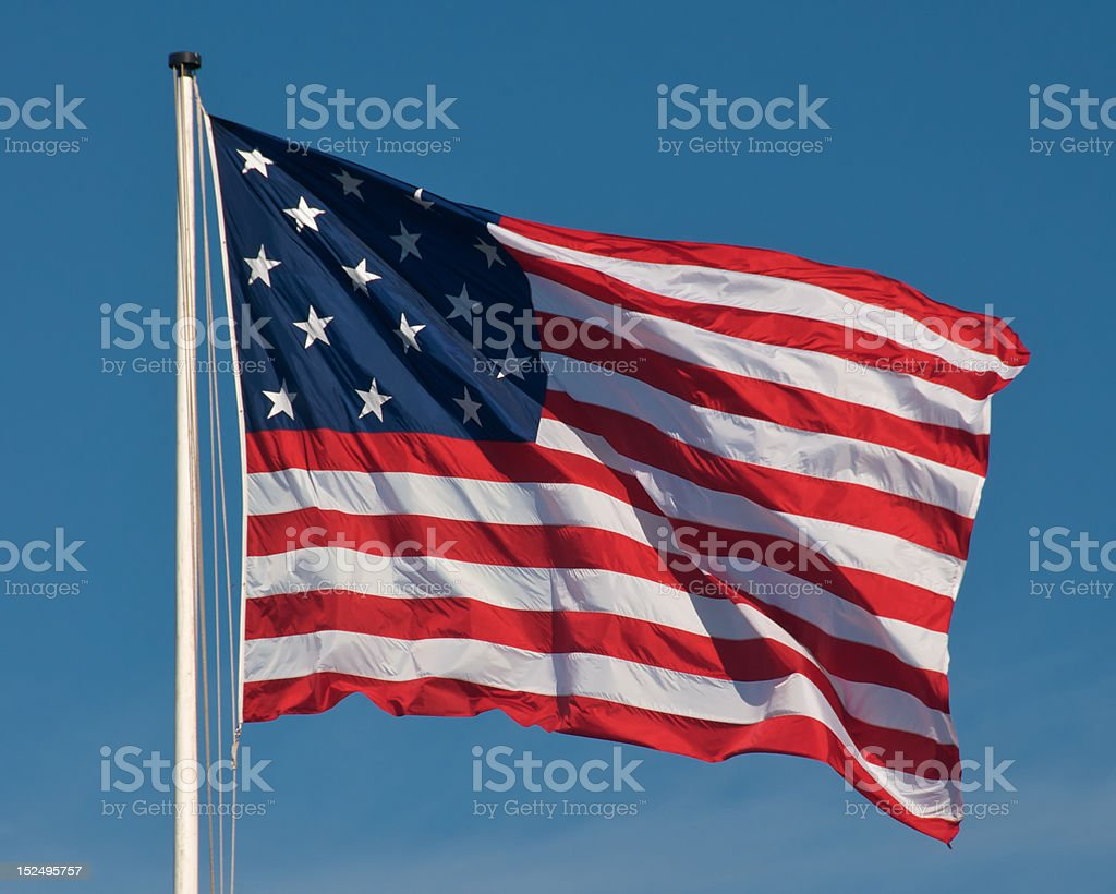 American Flag over Ft. McHenry stock photo