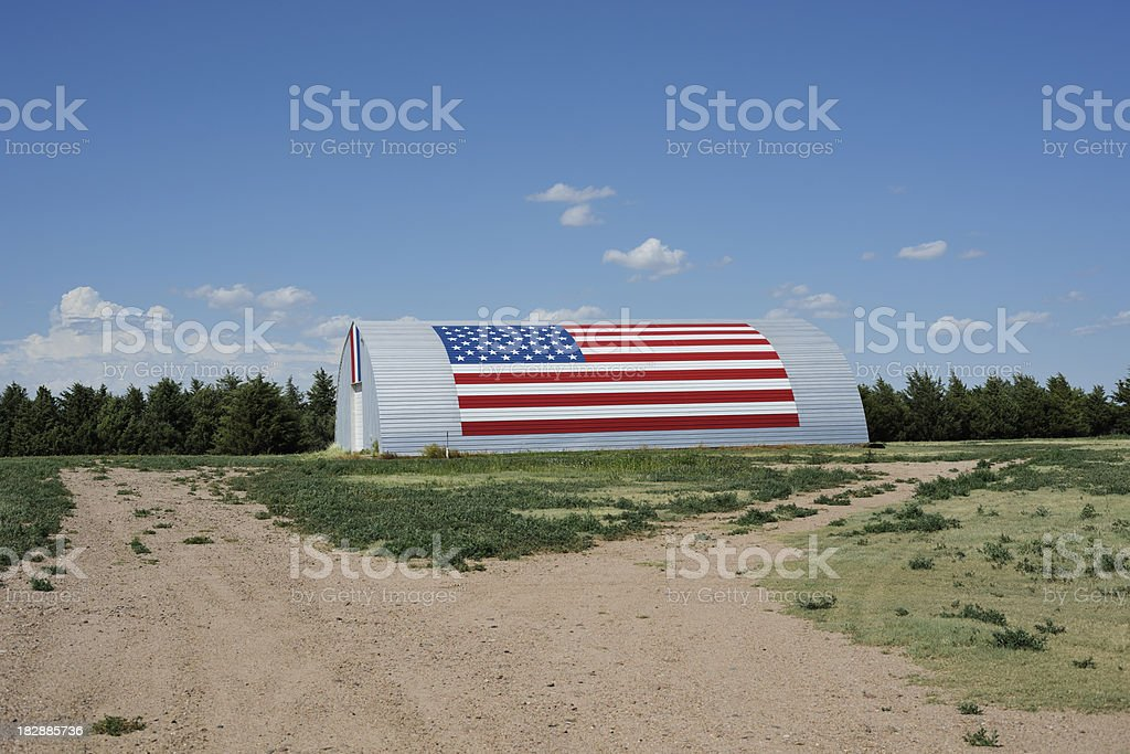 American flag painted on farm building stock photo