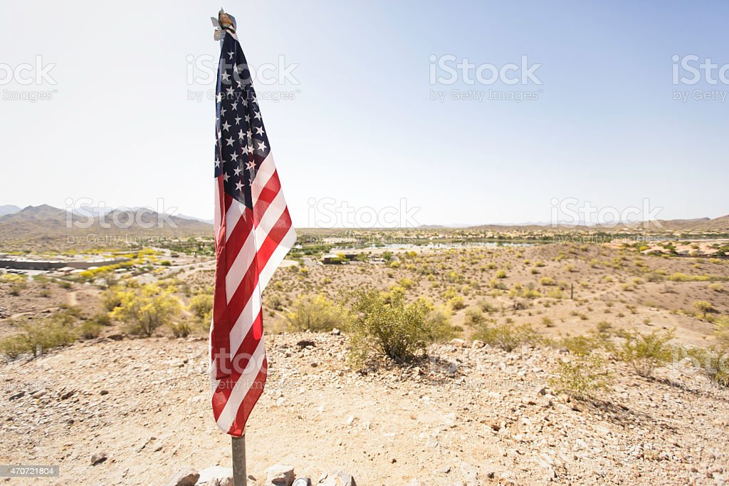 American Flag Resting in The Desert stock photo