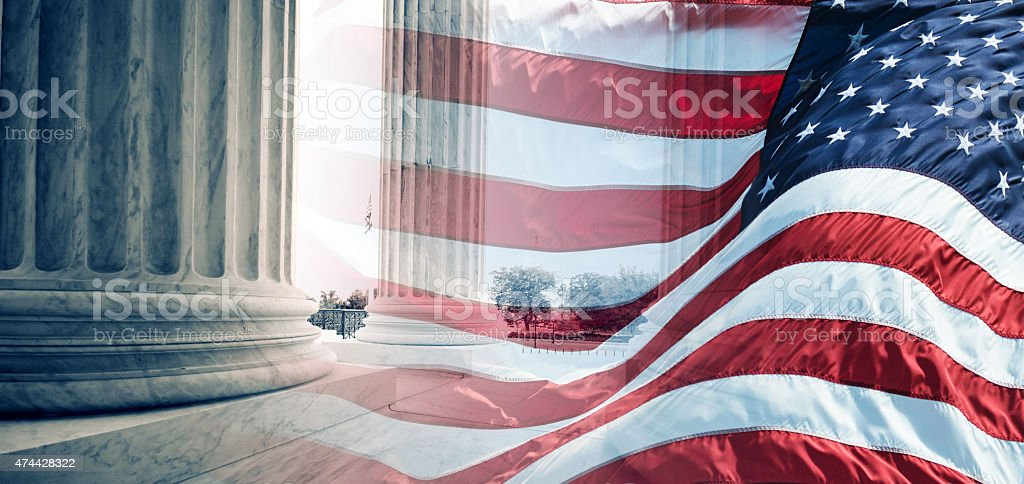 american flag waving for a national holiday in washington dc stock photo