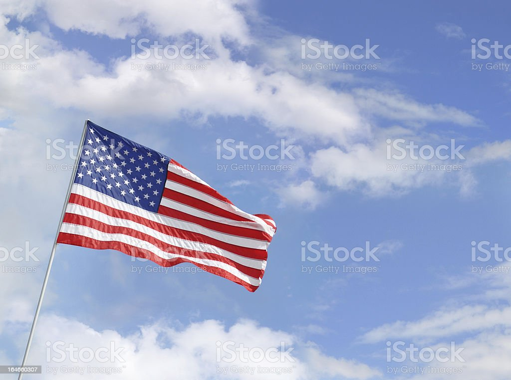 American Flag Waving in Blue Sky with Clouds royalty-free stock photo