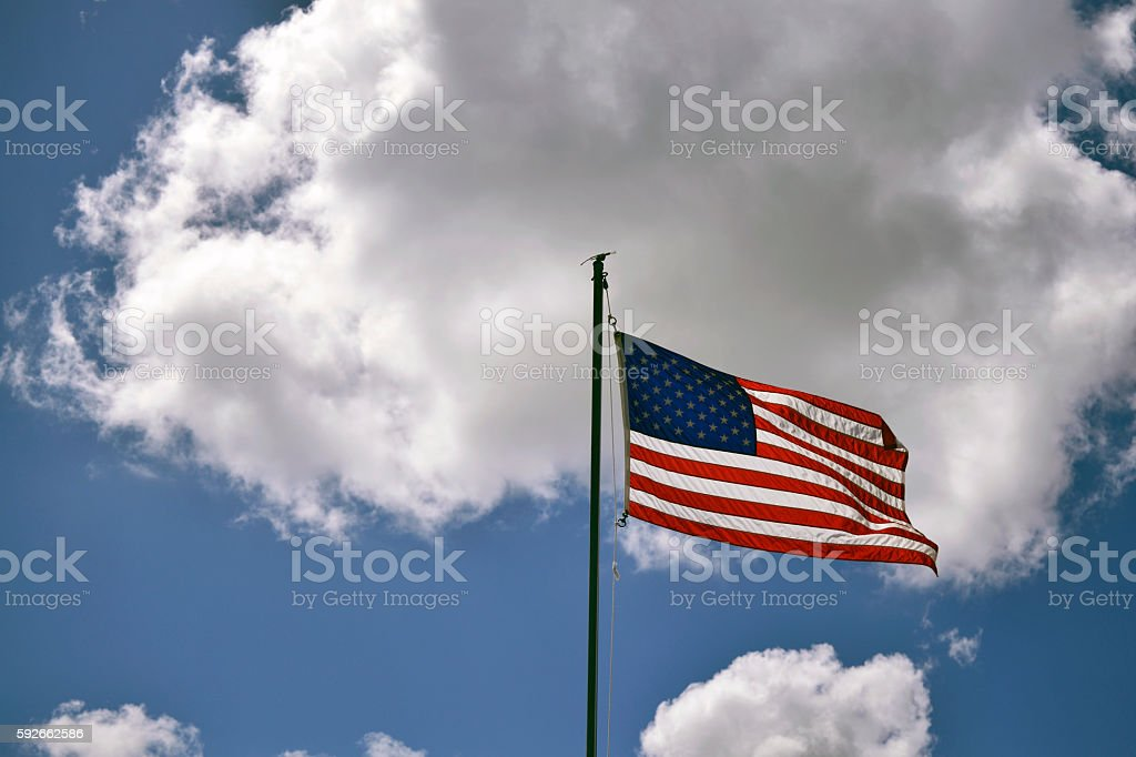 American flag waving in the clouds. stock photo