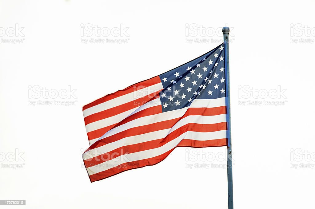 American flag waving on flagpole royalty-free stock photo