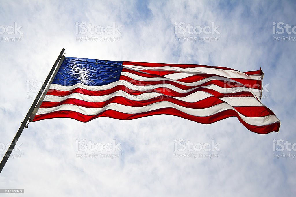American Flag with Blue Skies stock photo