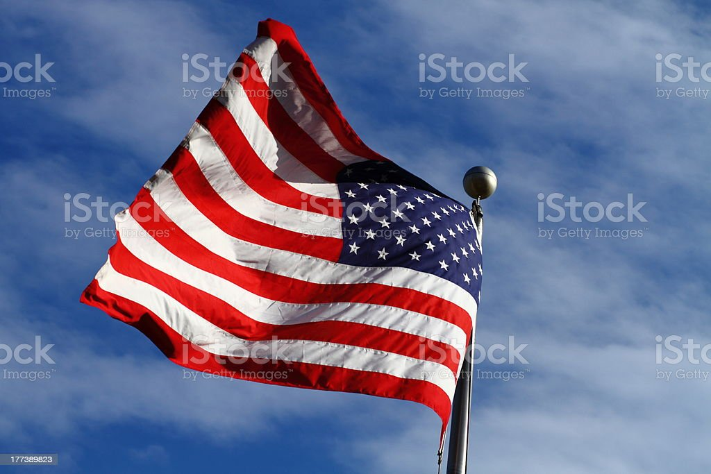 American flag with blue sky and clouds XL stock photo