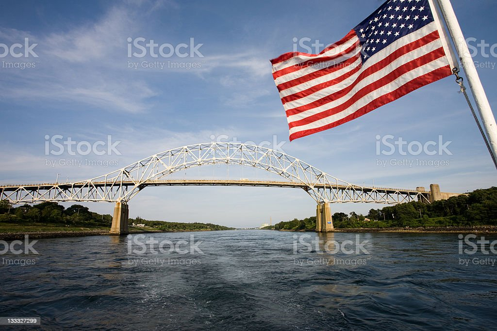 American Flag with the Sagamore Bridge and Cape Cod Canal royalty-free stock photo