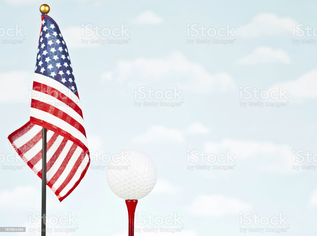 American Flag with White Golf Ball on Red Tee royalty-free stock photo