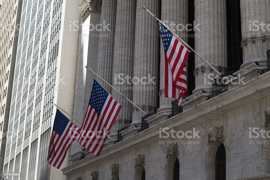 American flags and stock exchange stock photo