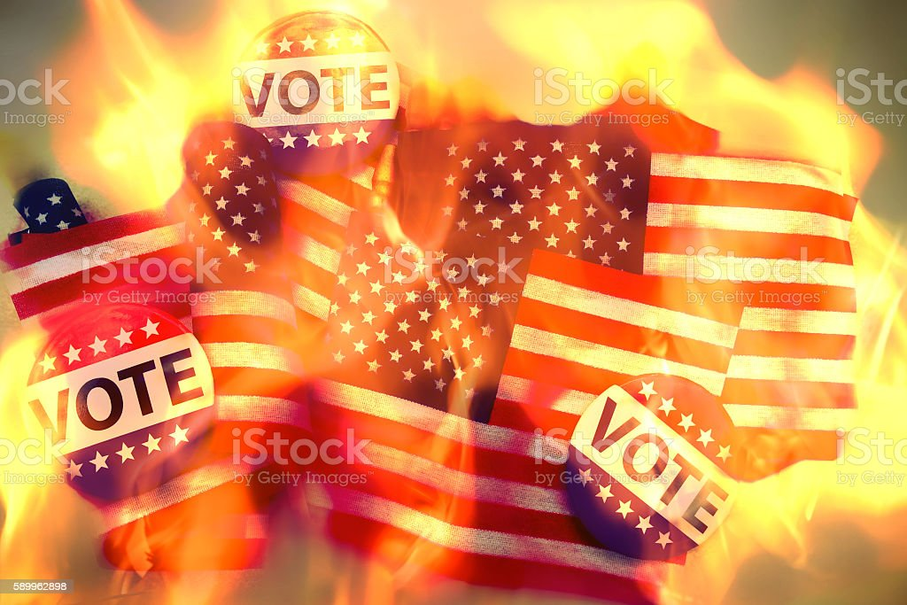 American flags and vote campaign buttons on fire: voter chaos stock photo
