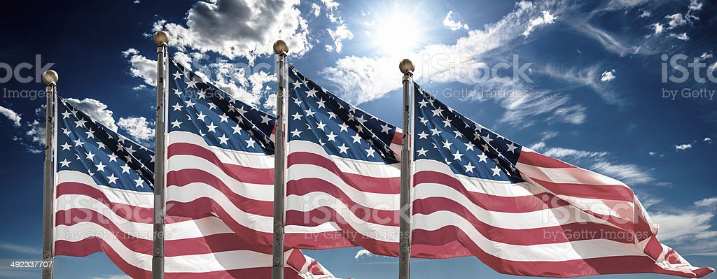 american flags waving for memorial day stock photo