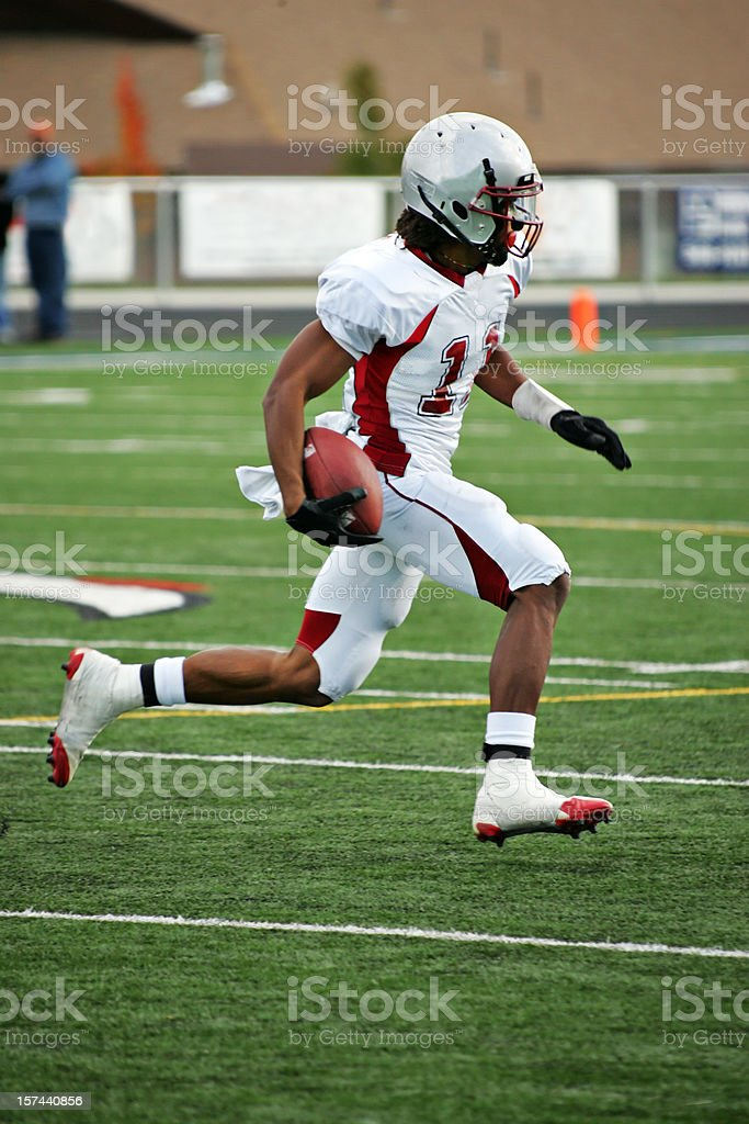 American Footbal Player in Flying Sprint after Pass Reception stock photo