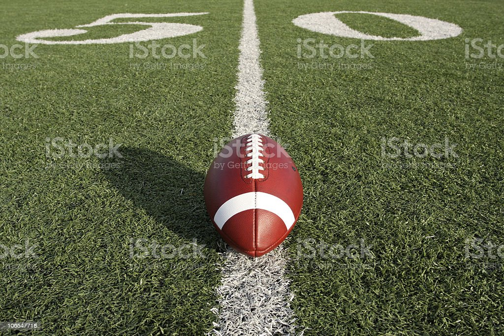 American Football along the Fifty Yard Line stock photo