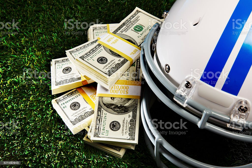 American Football and Cash stock photo
