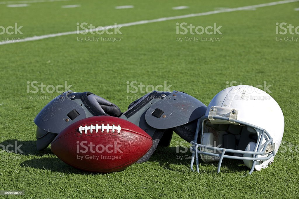 American Football and Helmet on the Field royalty-free stock photo