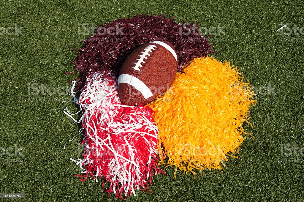 American Football and Pom Poms on Field stock photo