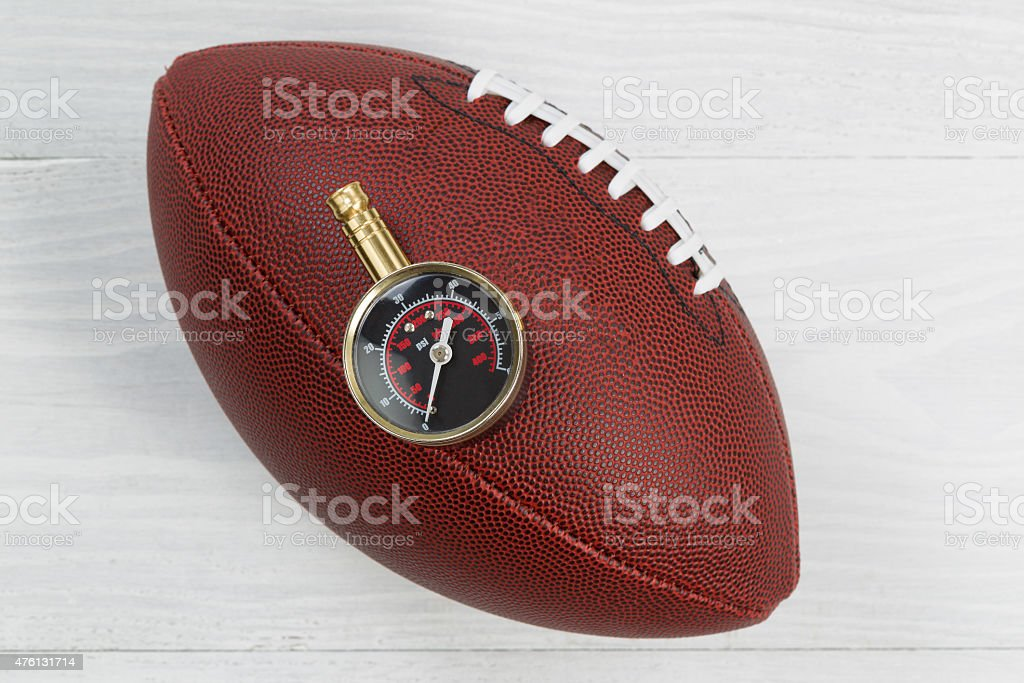 American football being tested for proper inflation of ball stock photo