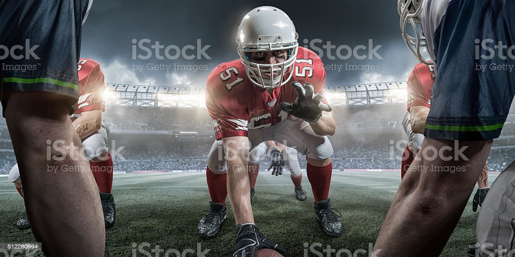 American Football Center in Offensive Line About to Snap Ball stock photo