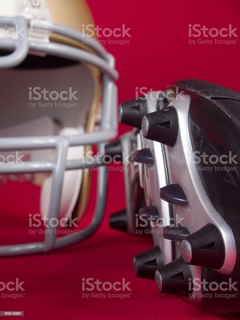 American Football Cleats & Helmet royalty-free stock photo