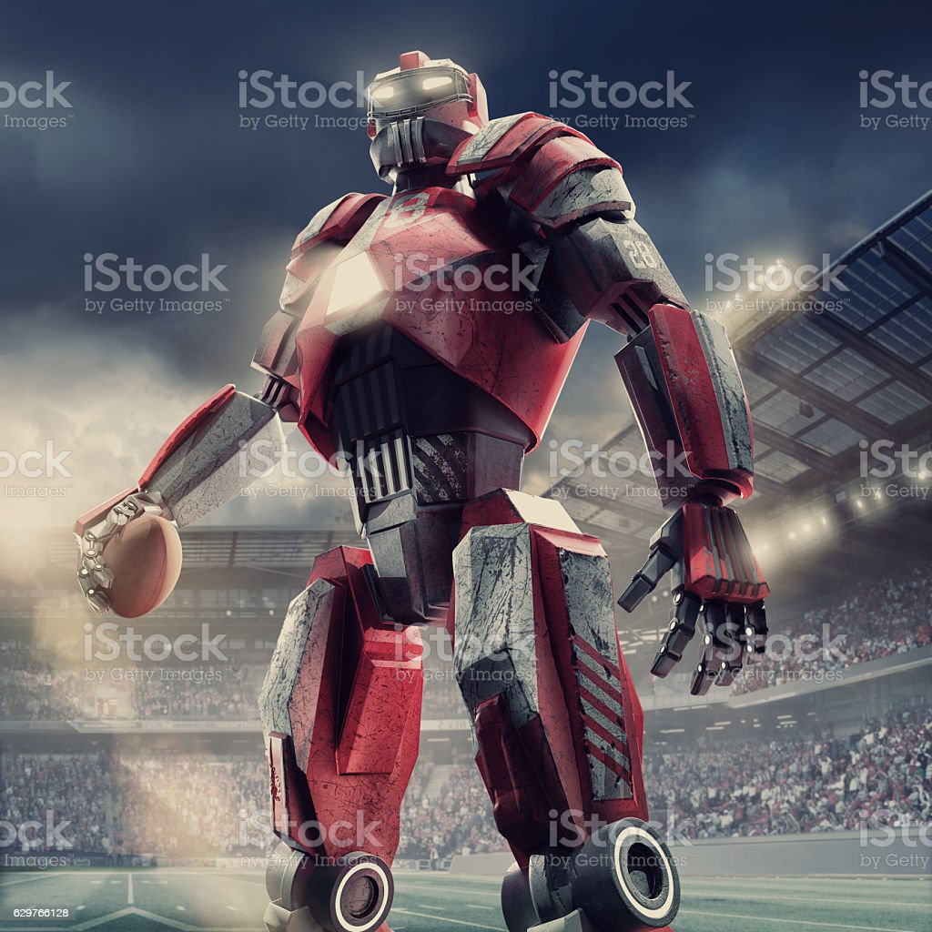 American Football Cyborg Standing With Ball In Football Arena stock photo