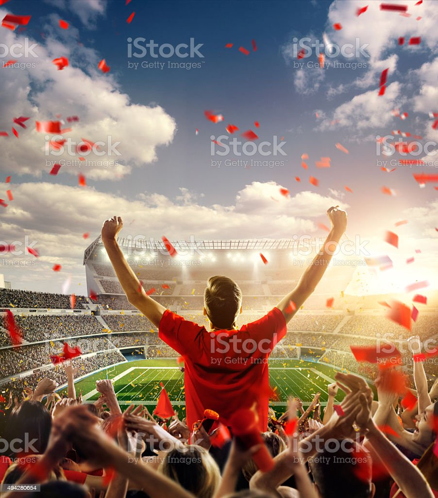 American football fans at stadium stock photo