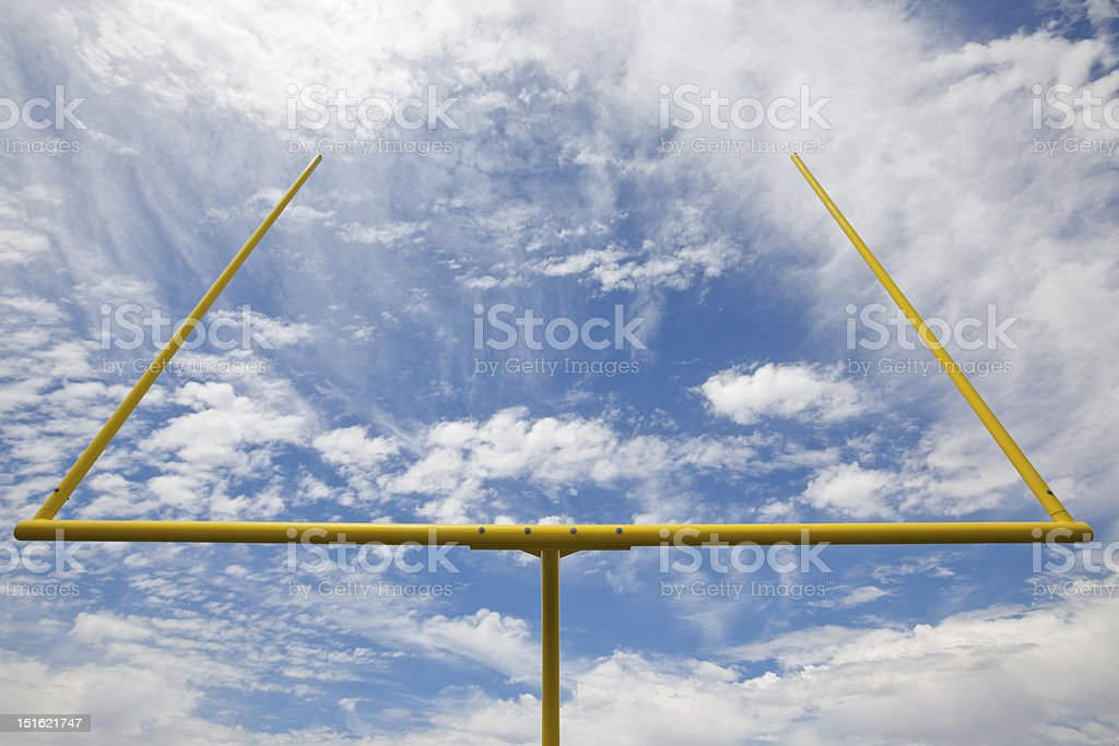 American football goal posts against clouds and blue sky royalty-free stock photo
