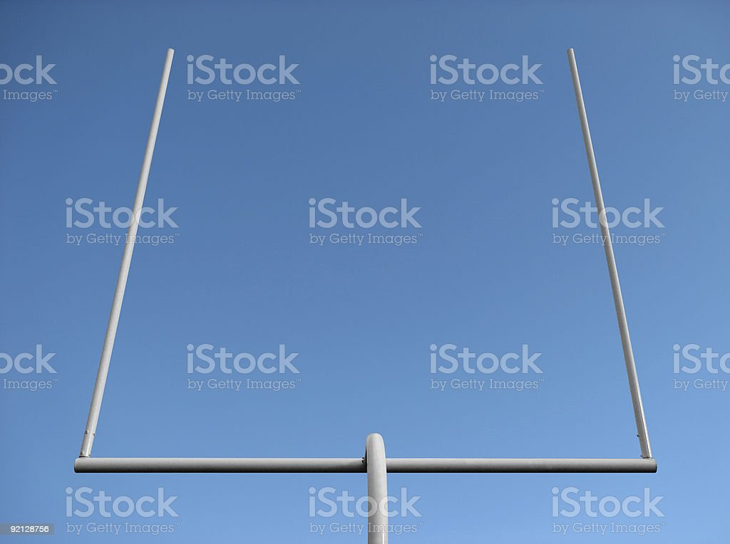 American football goal posts and the blue sky stock photo