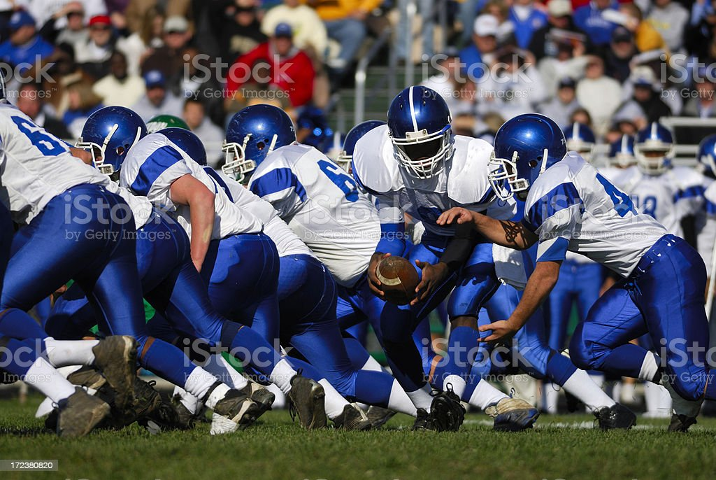 American Football, handing off the ball. stock photo