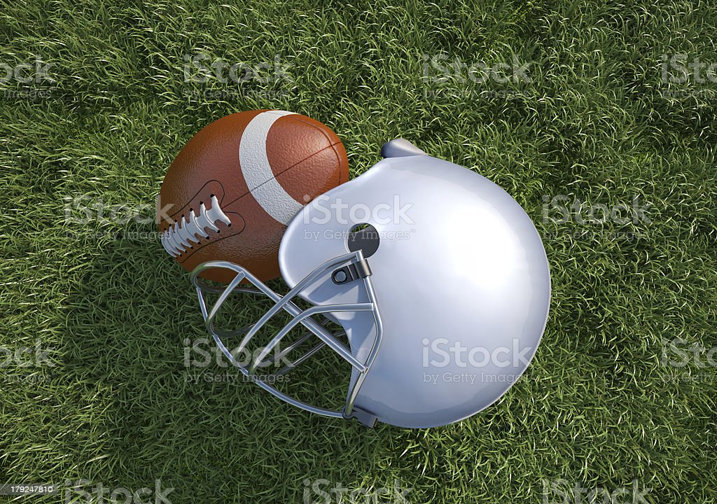 American football helmet and ball, on the grass. Close-up. royalty-free stock photo