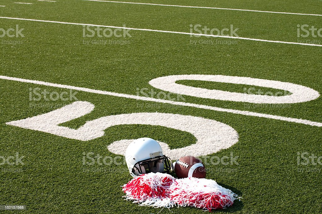 American Football, Helmet and Pom Poms on Field royalty-free stock photo
