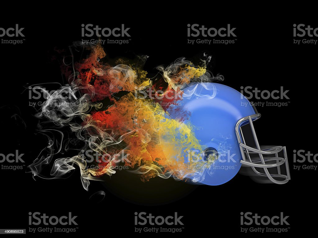 American football helmet in the colored smoke stock photo