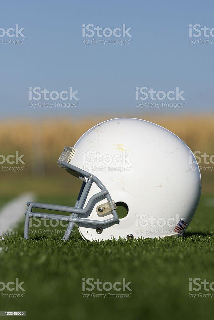 American Football Helmet on Field royalty-free stock photo