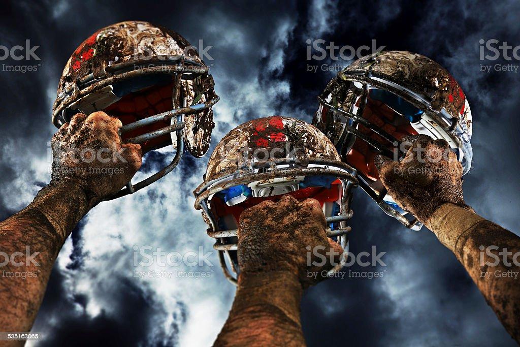 American Football Helmets on a Muddy Day stock photo