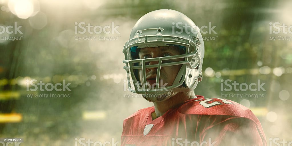 American Football Hero Portrait In Stadium During Rainy Game stock photo