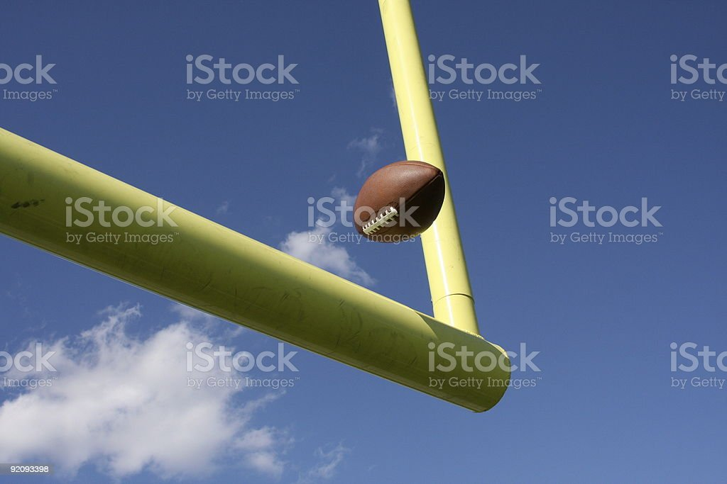 American Football kicked through the uprights or goal posts stock photo