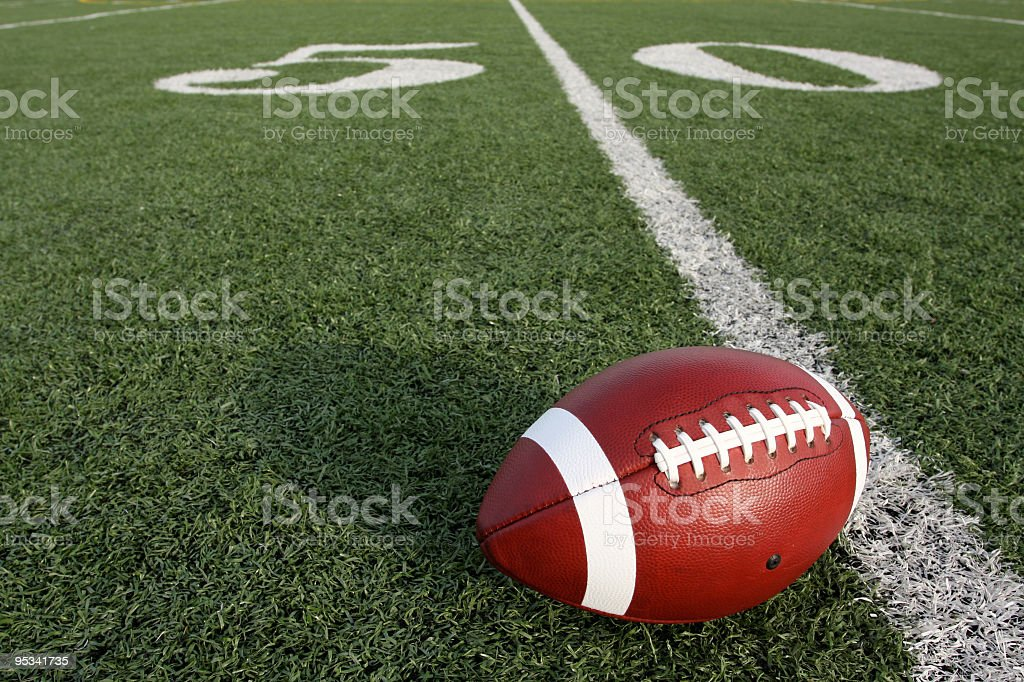American Football near the Fifty Yard Line stock photo