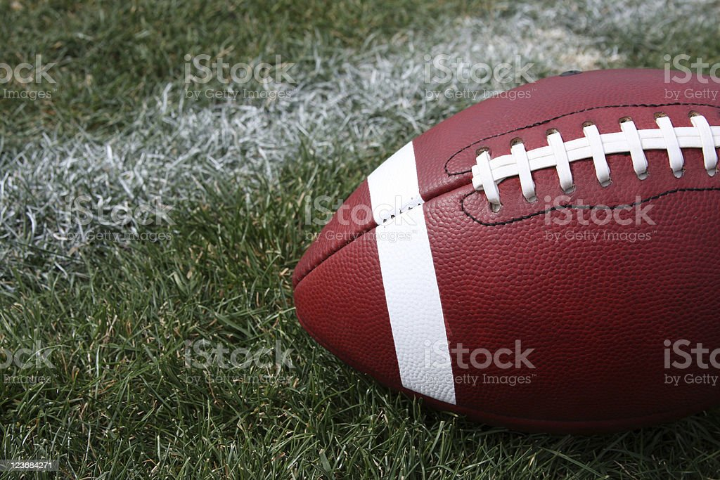 American Football on Grass royalty-free stock photo