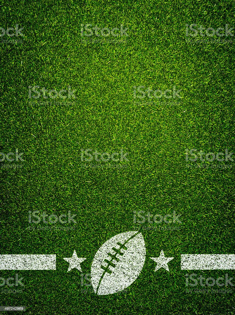 American football on grass stock photo