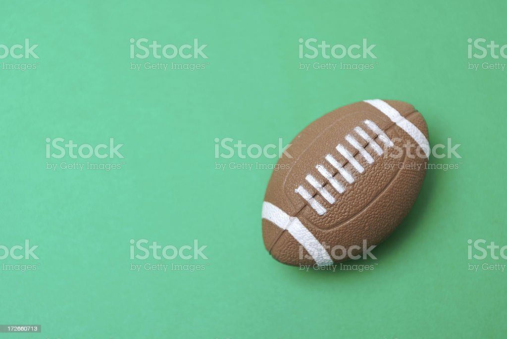 American Football on Green Background royalty-free stock photo