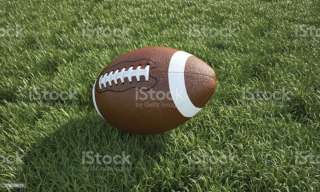American football on the grass. Close-up bird's-eye view. royalty-free stock photo