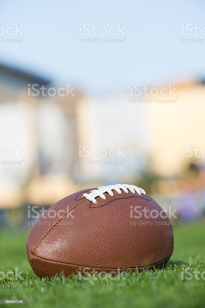 American football on the grass field stock photo