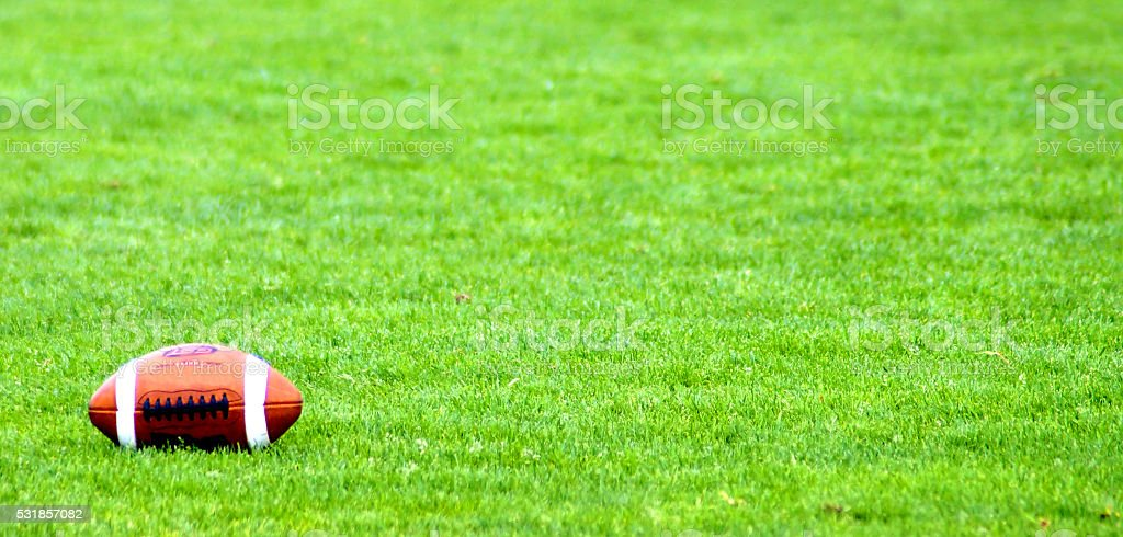 American Football on the ground stock photo