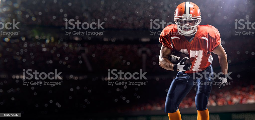 American football plaer on arena stock photo